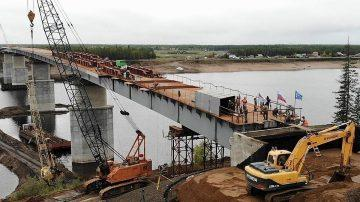 Строительство дороги через реку